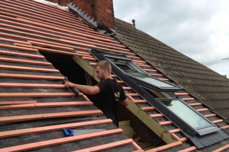 mans working on roof