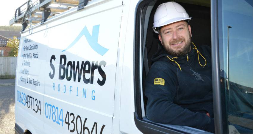 s bowers smiling in a van
